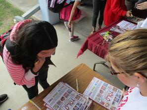 Students signing YOLO Pledges RRW Marathon.jpg