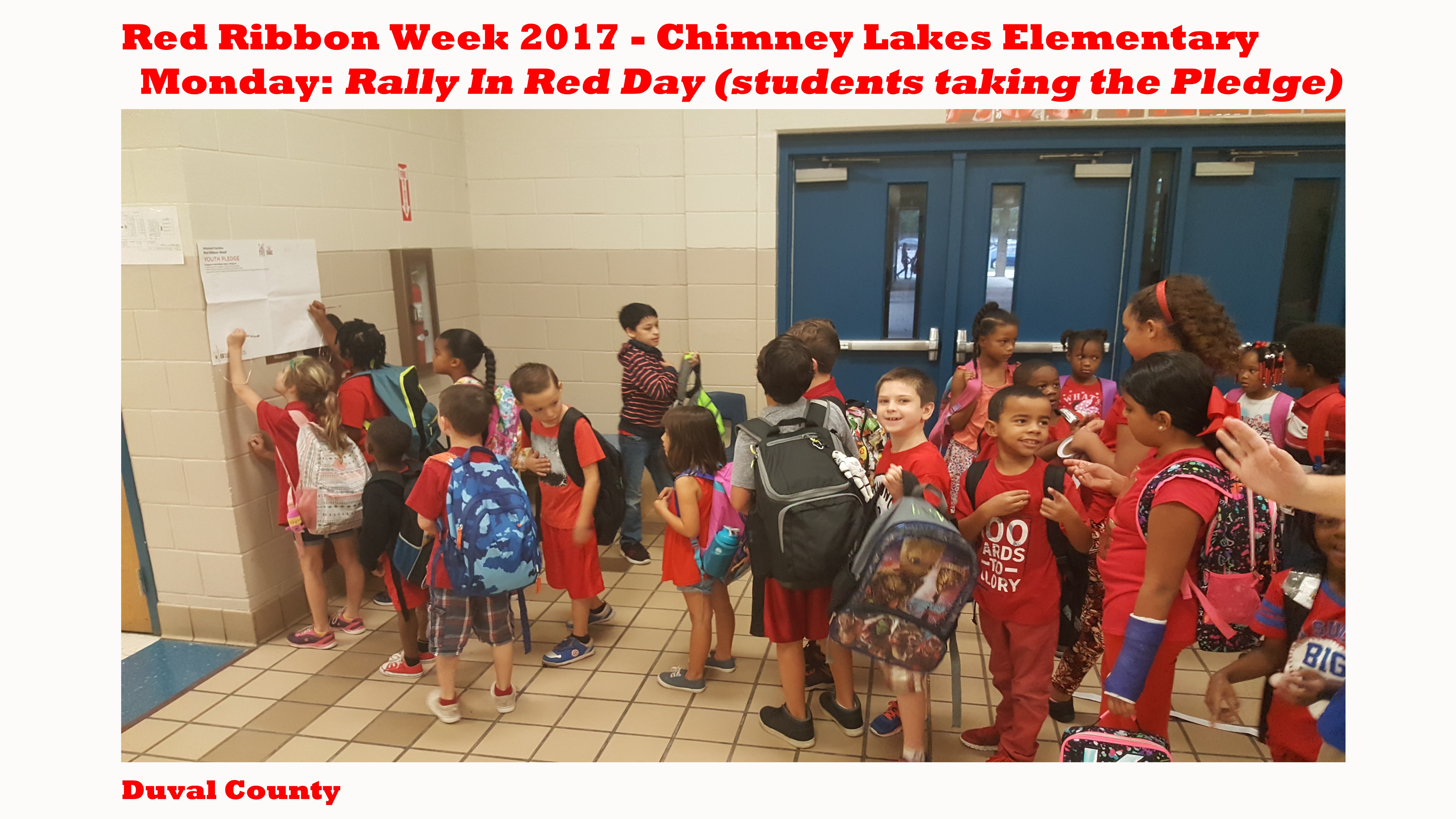 chimney lakes students taking the pledge and wearing red.png